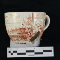 Brown transfer print cup (side a)
